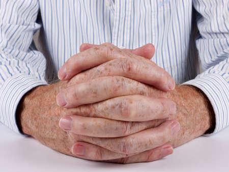 Customner service man - hands clasped closeup photo