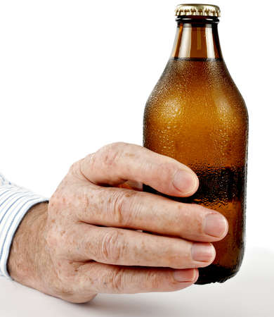 unopened: Male hand holding unopened, cold bottle of beer, with condensation