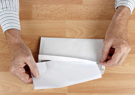 resignation: Male hand posting letter - resignation application maybe Stock Photo