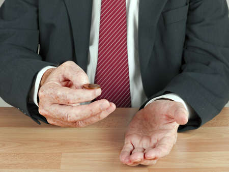 tossing: Businessman tossing a uk coin - risk, decision concept