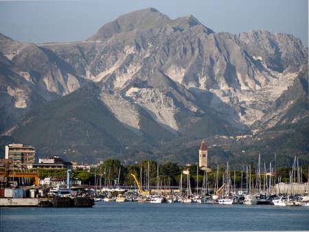 carrara: Marina di Carrara  from off-shore with marble mountains Stock Photo