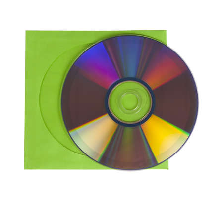 CD or DVD with green paper case, isolated over white background photo