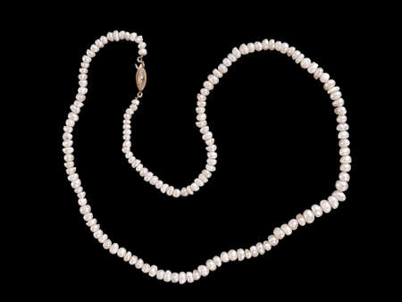 freshwater pearl: Freshwater pearl necklace isolated over black  Stock Photo