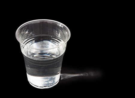 sidelit: Glass of drinking water over black, sidelit