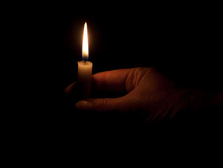 Candle light in the darkness photo
