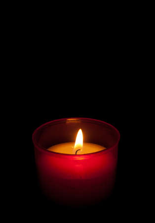 votive: Candle in the dark