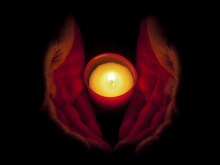 votive candle: In memoriam - hands with red, votive candle Stock Photo