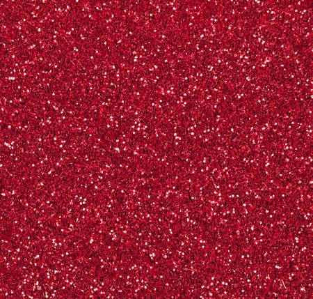 Red sparkly Christmas or festive background Standard-Bild