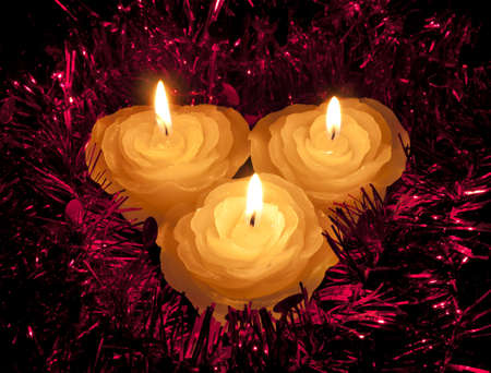 Rose shape candles in tinsel - Christmas or festive photo