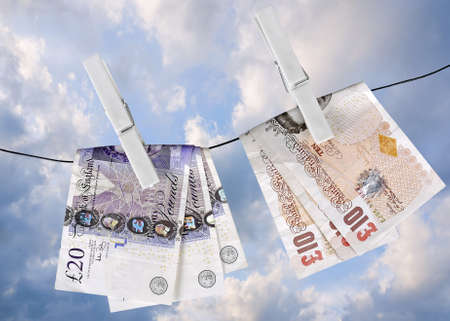 UK money hung out to dry with pegs Imagens