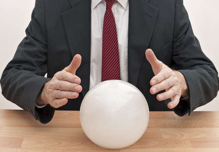Businessman with crystal ball - concept photo