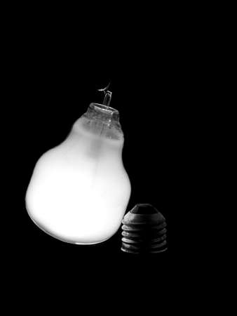 Broken light bulb - monochrome photo