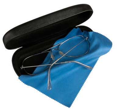 opthalmology: Old spectacles aka glasses with case and cloth, isolated Stock Photo