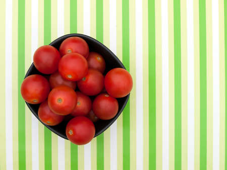 Small red tomatoes in bowl photo