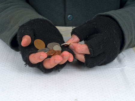 Poverty concept - counting pennies UK pounds, sterling Stock Photo - 16390265