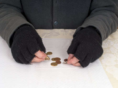 Poverty concept - counting pennies euros Stock Photo - 16390264