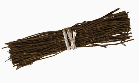 Budle of twigs, tied, isolated over white background photo