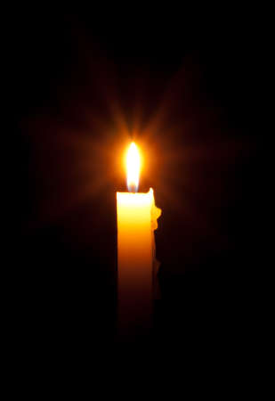 Candle in the dark - slow exposure rays Stock Photo - 18027373