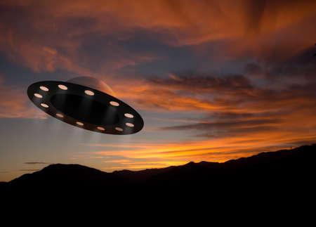 Alien space ship aka ufo at sunset Standard-Bild