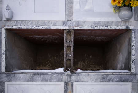 empty tomb: Cold and empty tombs with snow