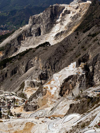 Marble mountain quarry with hairpin bends road photo