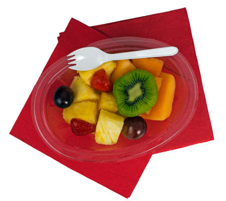 serviettes: Picnic style prepared fruit salad on red serviettes, isolated