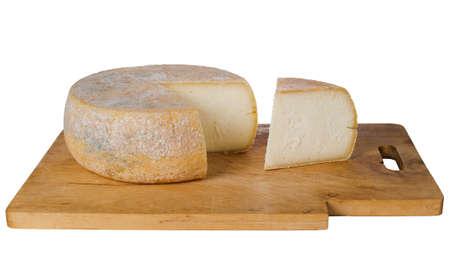 Farmhouse cheese on board, isolated