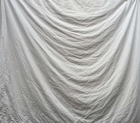 draped: Sheet - fabric draped on washing line, background