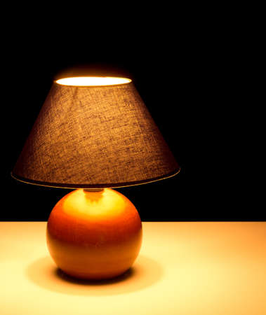Bedside lamp at night photo