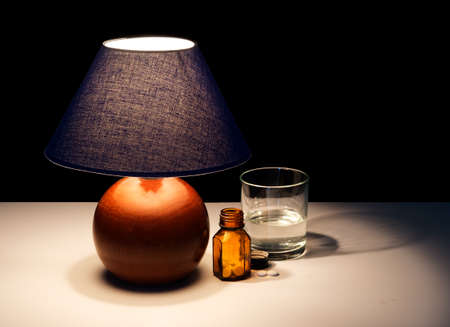 bedside: Night time pills and water