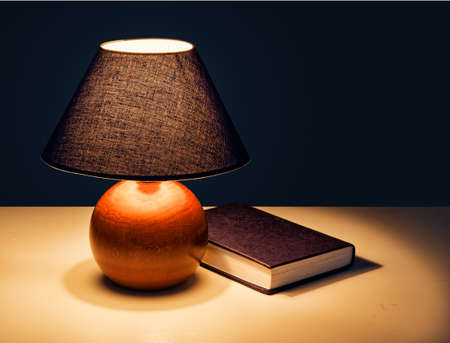 'bedside table': Book at bedtime with real lamplight - hence shadows