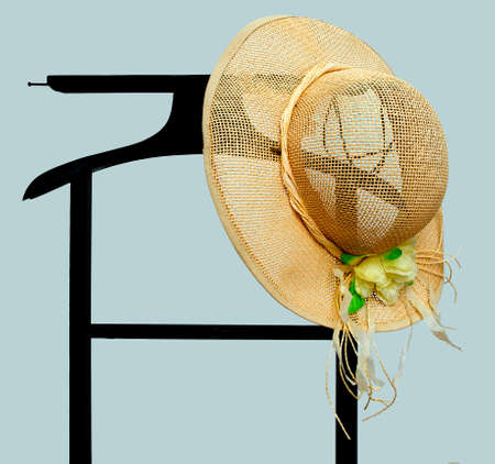 valet: Summertime sunhat on hotel style valet, stand  Stock Photo