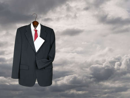 Grey suit against gray sky with envelope - funeral director maybe Stock Photo - 26038037