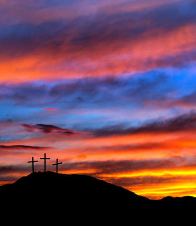 christian crosses: Real sunset  Christian religious Easter background with three crosses Stock Photo