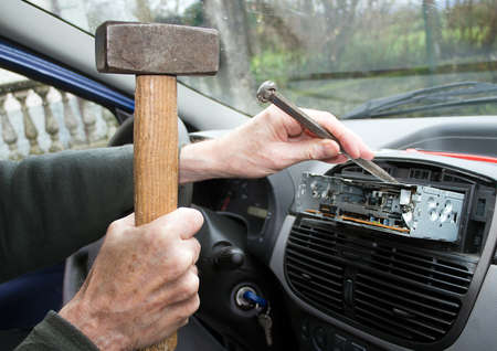 unprofessional: Hammer and chisel  Amateur replaces car radio