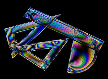 interference: Rainbow stress, interference patterns  Geometry set, plastic  Stock Photo