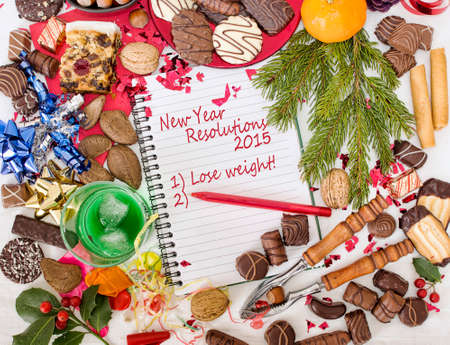 overindulgence: Overindulgence - Christmas festival followed by new year resolution to lose weight  Stock Photo