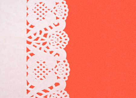doiley: Pretty doily on red background