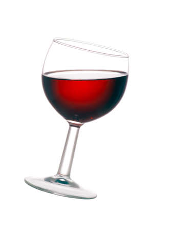 tilted: Backlit glass of red wine isolated over white background.