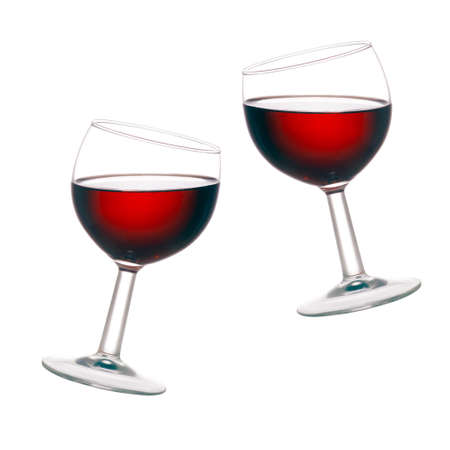Backlit wine glasses with red wine, isolated over white background. photo