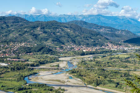 apennines: Magra river and Lunigiana, Italy. Apennine mountains in distance.