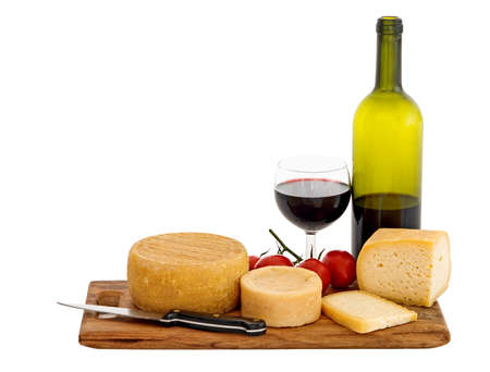 Cheese and wine isolated over white. Genuine organic farm produced cheeses. photo