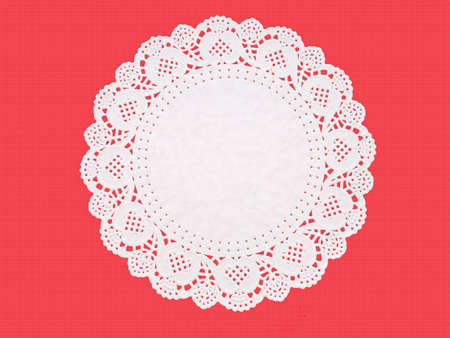 embossed paper: Paper embossed doily on red.