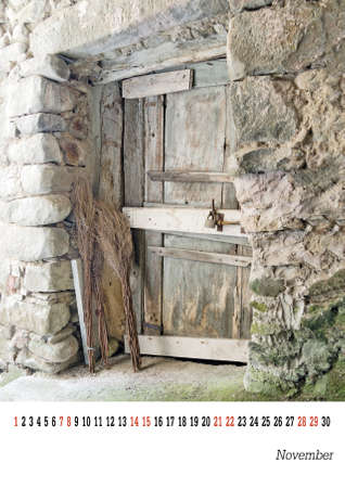 customisable: Calendar page 2105 - November. Easily customisable template. Old doorway with brooms.