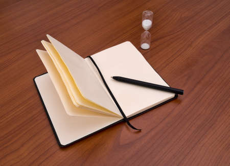 writer's block: No inspiration.... Pen, notebook and eggtimer. Writers block.