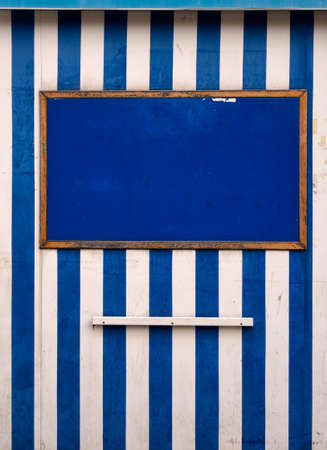bedraggled: Striped holiday seaside resort background. Vertical. Stock Photo