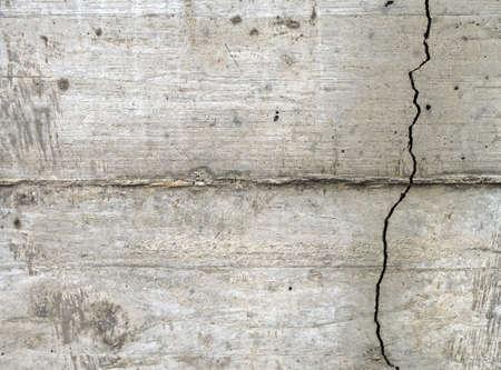 metaphorical: Actual or metaphorical crack in the concrte wall, horizontal Stock Photo