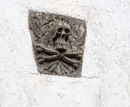 crossbones: Stone carved skull and crossbones