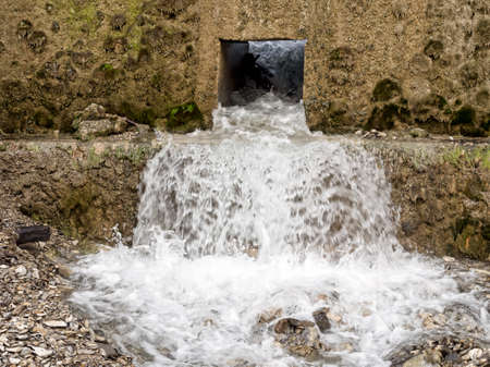 water hole: Water management, conservation. Gushing. Stock Photo