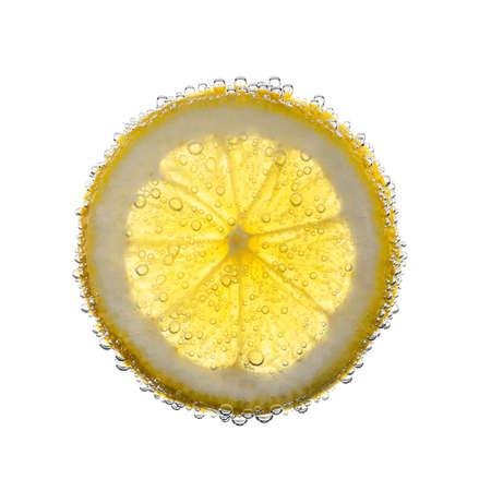 lemon water: Closeup of slice of lemon,underwater. Bubbly.